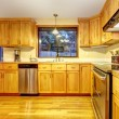 Royalty-Free Stock Photo: Golden wood kitchen with hardwood floor.