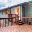 Stock Photo: Back of the house with wooden deck.