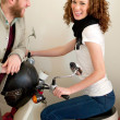 Happy laughing couple on the scooter. — Stock Photo