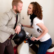 Young beautiful couple on the scooter flirting during date. — Stock Photo