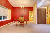 DIning room with red wall and small wood table. — Stock Photo