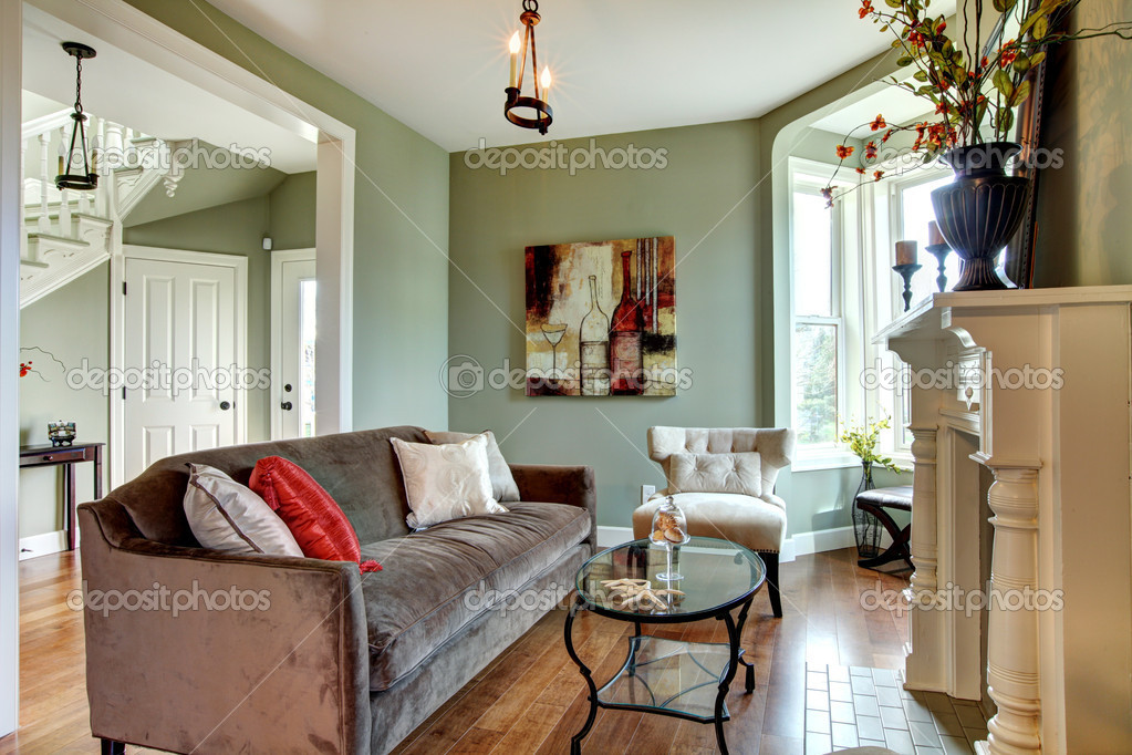 elegant green living room with brown sofa and wood floor.  stock, Living room