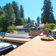 Beautiful lake waterfront property with dock and very large deck. — Stock Photo #9289065