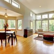 Large dinng room and living room in a modern house with many windows. — Stock Photo #9289974