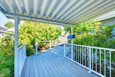 Covered walkway to the house with railings. — Stock Photo