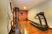 Modern home gym in the basement. — Stock Photo