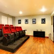Stock Photo: Home TV movie theater entertainment room interior.