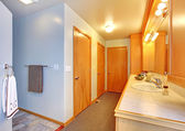 Bathroom house interior with many doors to closets. — Stock Photo