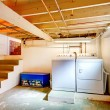 Basement laundry room with old appliances. — Stock Photo