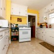 White and yellow old simple kitchen. — Stock Photo