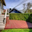 Small private back yard with new deck. — Stock Photo