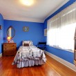 Bright blue bedroom with doll house. — Stock Photo