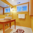 Orange modern bathroom with round sink. — Stock Photo #9582741