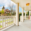 Front porch house exterior with spring street — Stock Photo