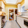 Stock Photo: Yellow and white simple kitchen with skylight.