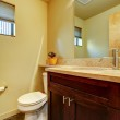 Small yellow bathroom with wood. — Stock Photo