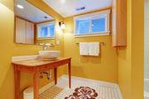 Orange modern bathroom with round sink. — Stock Photo