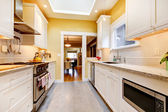 Yellow and white simple kitchen with skylight. — Stock Photo