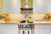 WHite kitchen cabinets with stove and hood. — Stok fotoğraf