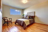 New bedroom with hardwood floor. — Stock Photo