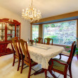 Dining room with large window in American house. — Stock Photo