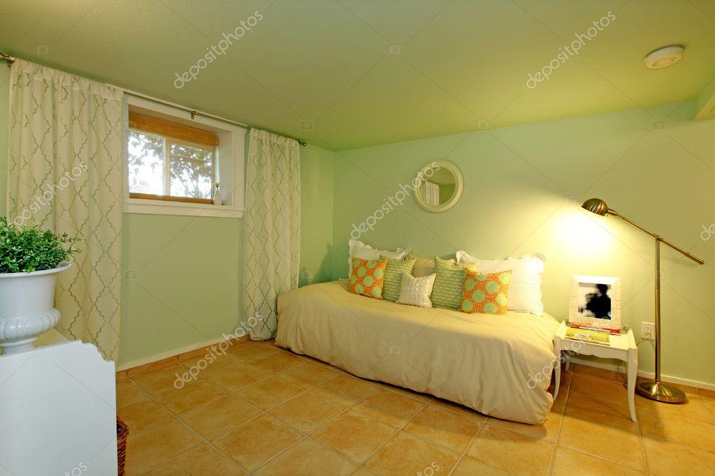 green basement living room with white sofa