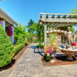 Stock Photo: Backyard with outdoor living room.
