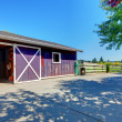 Royalty-Free Stock Photo: Horse farm shed in purple on American farm.