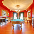 Red billiard luxury room with play pool. — Stock Photo