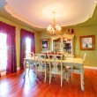 Stock Photo: Large green dining room with cherry hardwood.