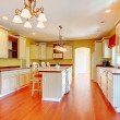 Gold kitchen with white antique cabinets. — Stock Photo #9979905
