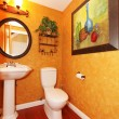 Orange bathroom with large painting. — Stock Photo