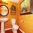 Orange bathroom with large painting. — Stock Photo
