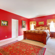 Red classic bedroom with large bed. — Stock Photo