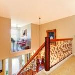 Luxury home hallway with metal railings. — Stock Photo