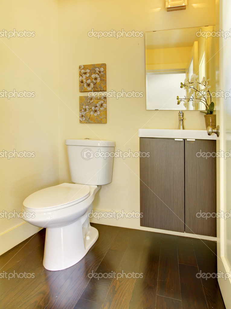 Small simple yellow moern bathroom stock photo for Small bathroom yellow