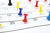 Calendar with pushpins — Stock Photo