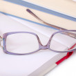 Purple glasses on books — Stock Photo