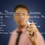 Businessman write business strategic planning on the whiteboard. — Stock Photo