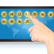 Hand pushing digital button on tablet screen. — Stock Photo