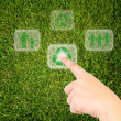 Royalty-Free Stock Photo: Hand pressing recycle icon on the grass field.