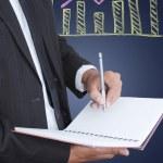 affärsman skriva på anteckningsboken — Stockfoto