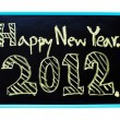 New Year 2012 word handwritten with chalk on a blackboard. — Stock Photo