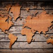 Vintage world map carving on wood texture. — Stock Photo