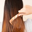 Lady to comb her hair. — Stock Photo #10267855