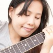 Woman playing classic acoustic guitar. — Stock Photo