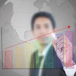 Businessman write finance graph for trade stock market on the whiteboard. — Stock Photo