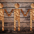 Vintage man and child symbol on the wood texture. — Stock Photo #10494711