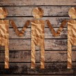 Vintage man and child symbol on the wood texture. - Stock Photo