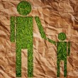 Vintage man and child symbol on the grass field. — Stock Photo